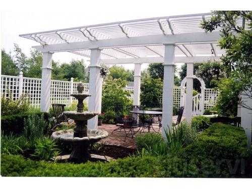 Private courtyard including paver patio, pergola, privacy fence and plantings for color and texture for all seasons.