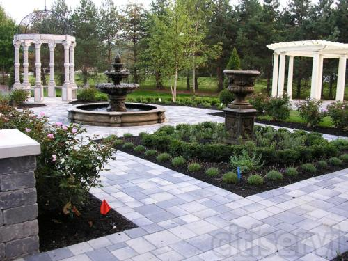European style formal garden including several patios, granite gazebo, curved pergola, Roman fountain, outdoor kitchen, decorative pond, and plenty of color and texture for all season interest with plantings.