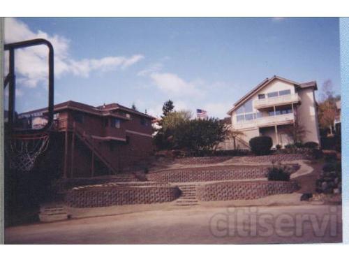 hillside yard transformed into terrace blockwalls