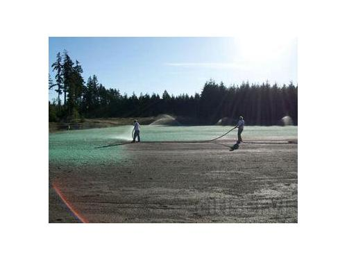 Spraying Hydroseed onto ball field